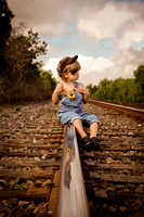 Boy on the Railroad Tracks